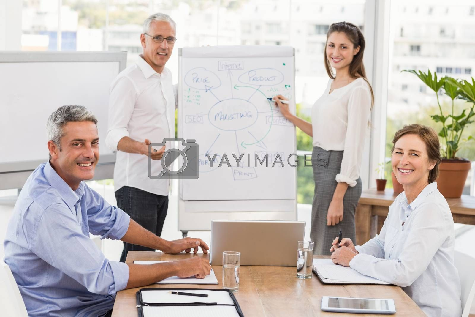 Portrait of smiling business people having a meeting in the office
