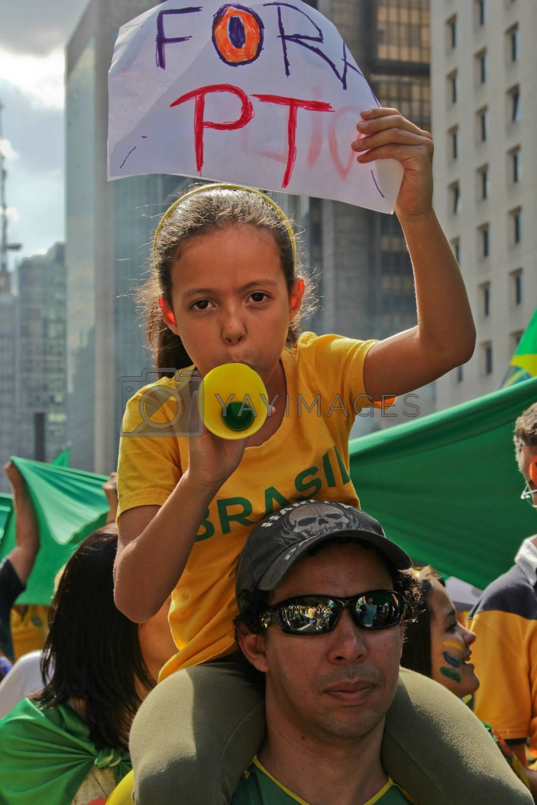 SAO PAULO, BRAZIL August 16, 2015: An unidentified man with a girl with a poster in the protest against federal government corruption in Sao Paulo Brazil.
