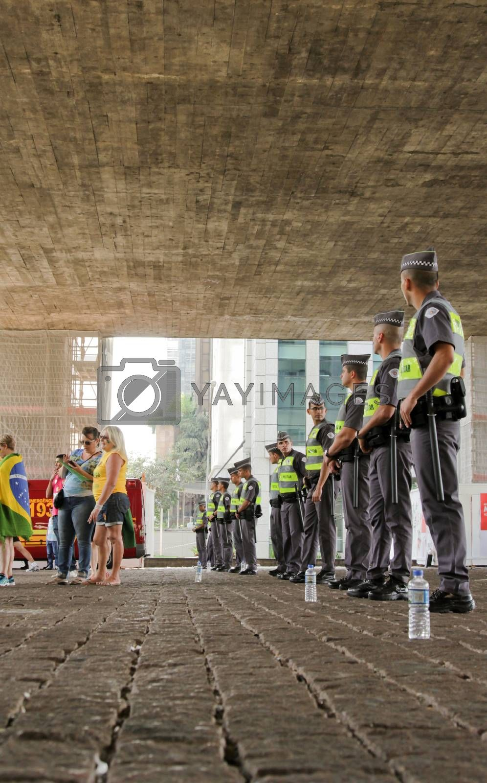 SAO PAULO, BRAZIL August 16, 2015: An unidentified group of cops take care of security in the protest against federal government corruption in Sao Paulo Brazil.