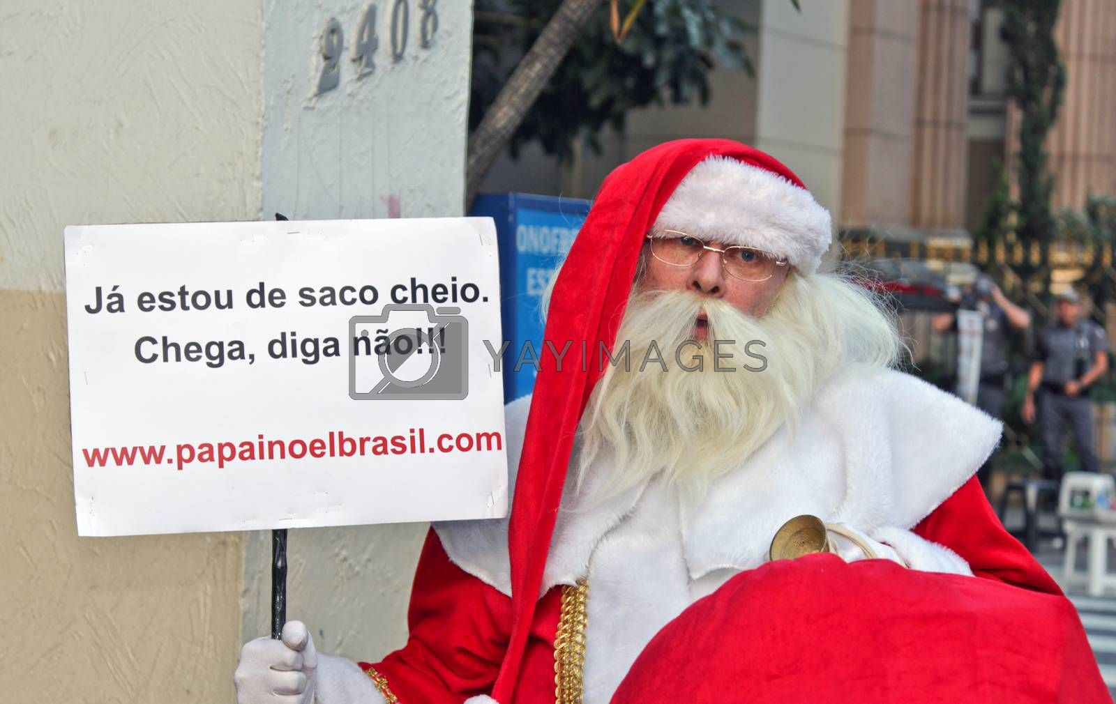 SAO PAULO, BRAZIL August 16, 2015: An unidentified man with the Santa Clau costume in the protest against federal government corruption in Sao Paulo Brazil.