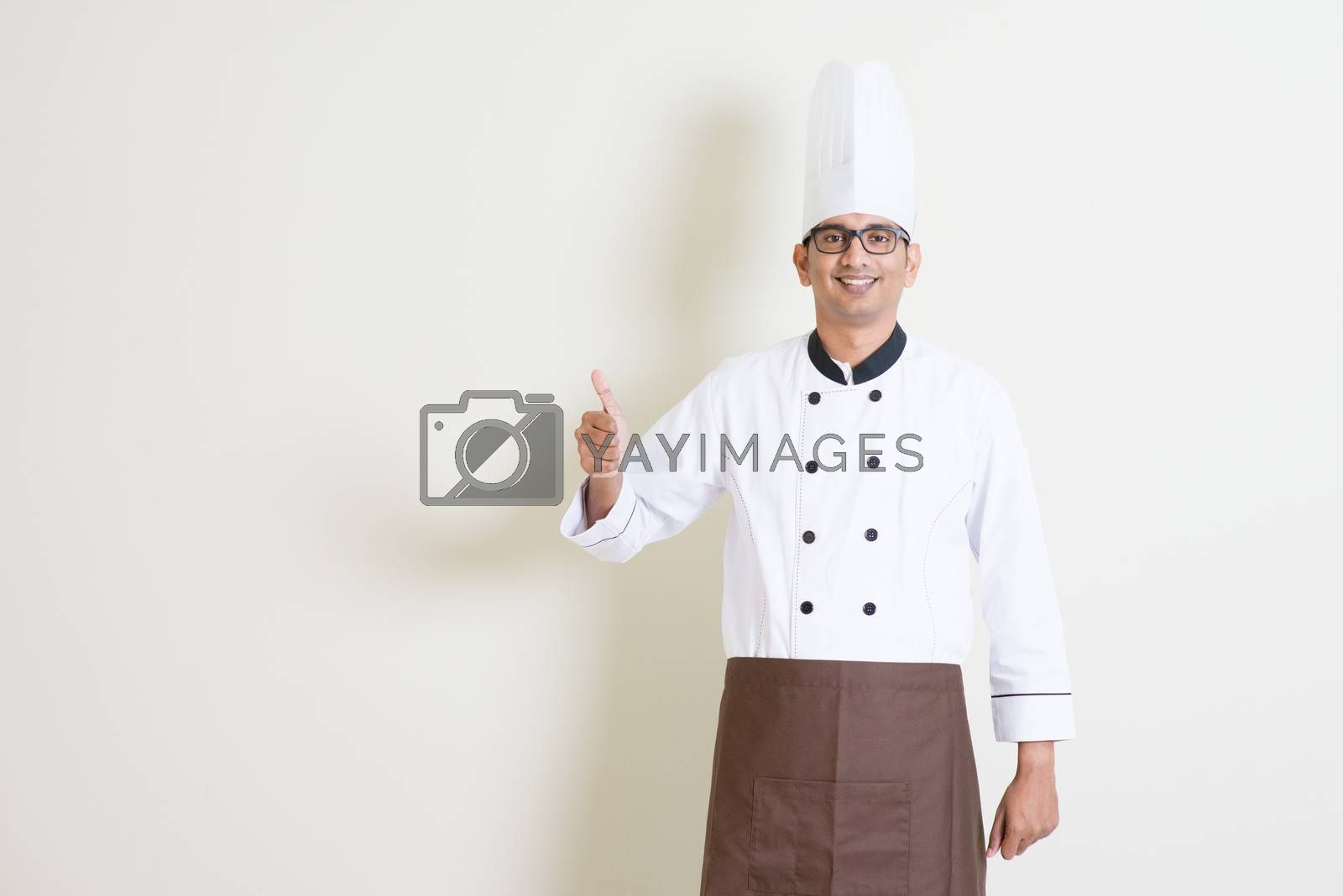 Handsome Indian male chef in uniform thumb up by szefei