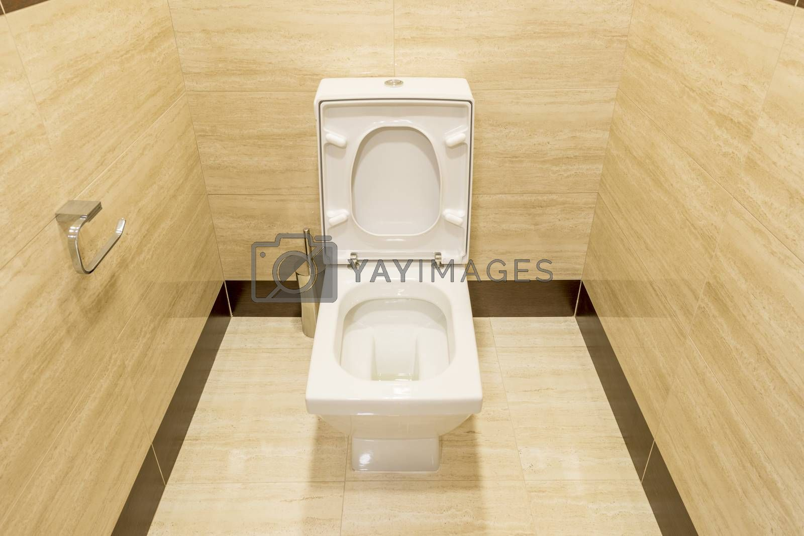 White toilet in the interior of the restroom by rogkoff
