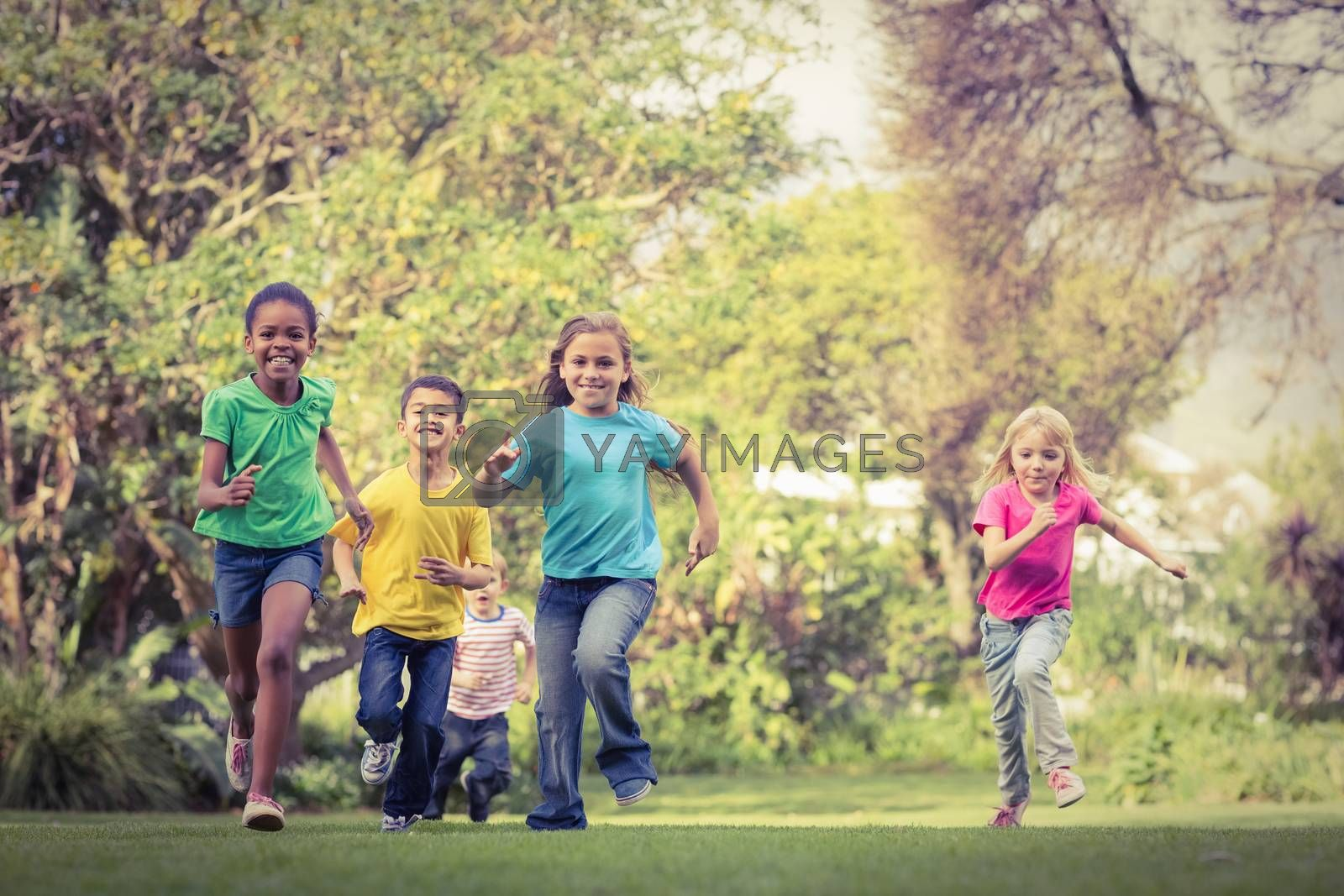 Happy classmates running around on campus