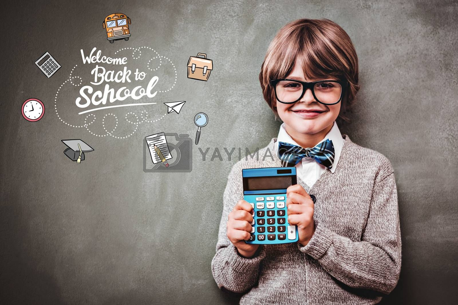 back to school against portrait of cute little boy holding calculator