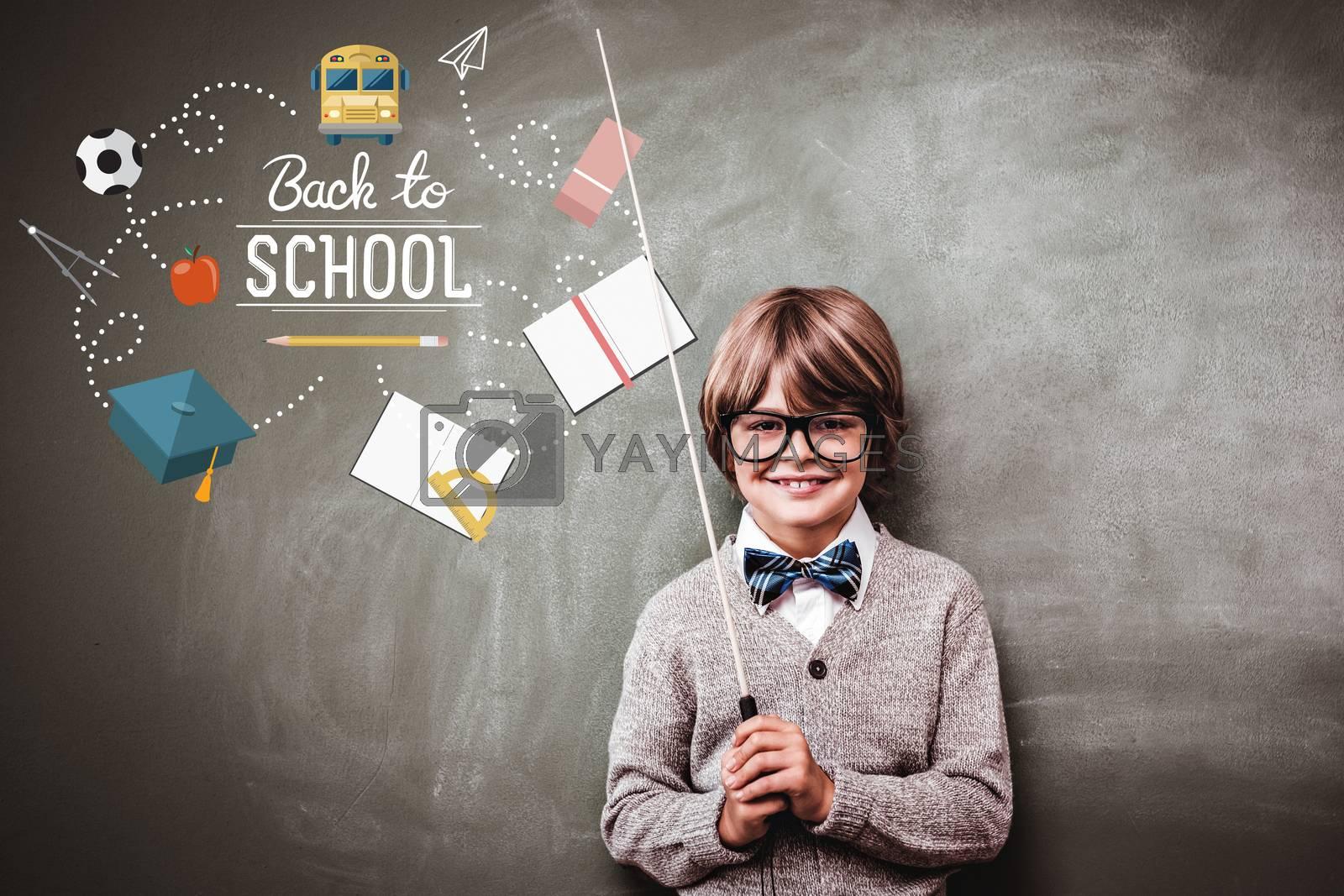 back to school against portrait of cute little boy holding stick