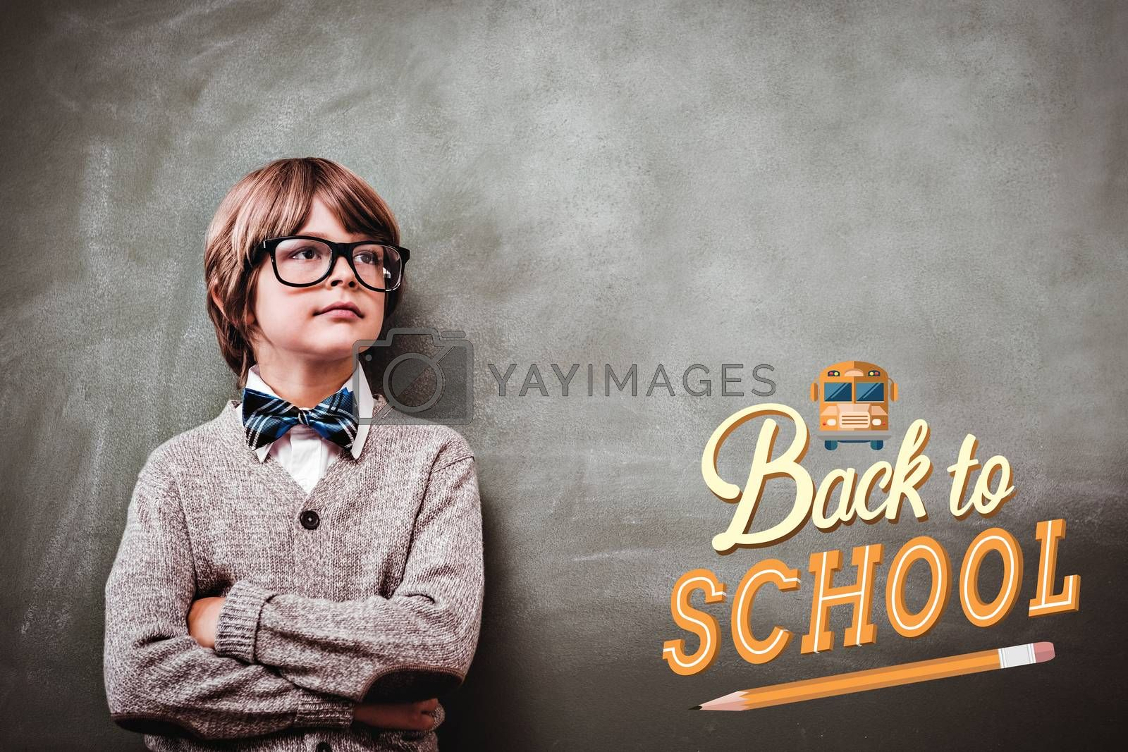 back to school against boy with arms crossed looking up at blackboard