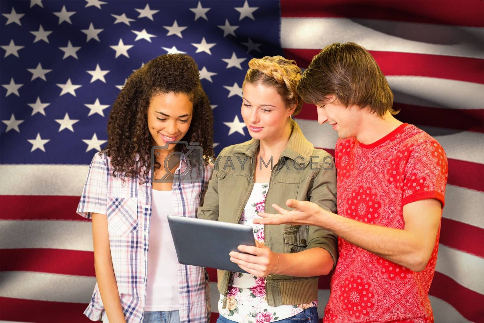 Students using digital tablet in library against digitally generated american national flag