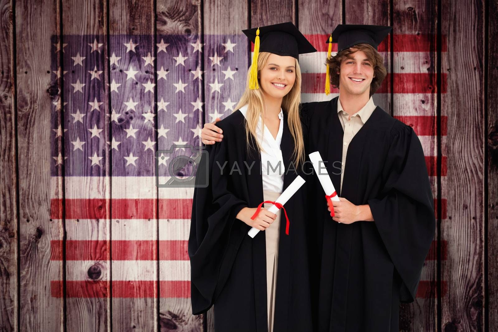 Two students in graduate robe shoulder to shoulder against composite image of usa national flag