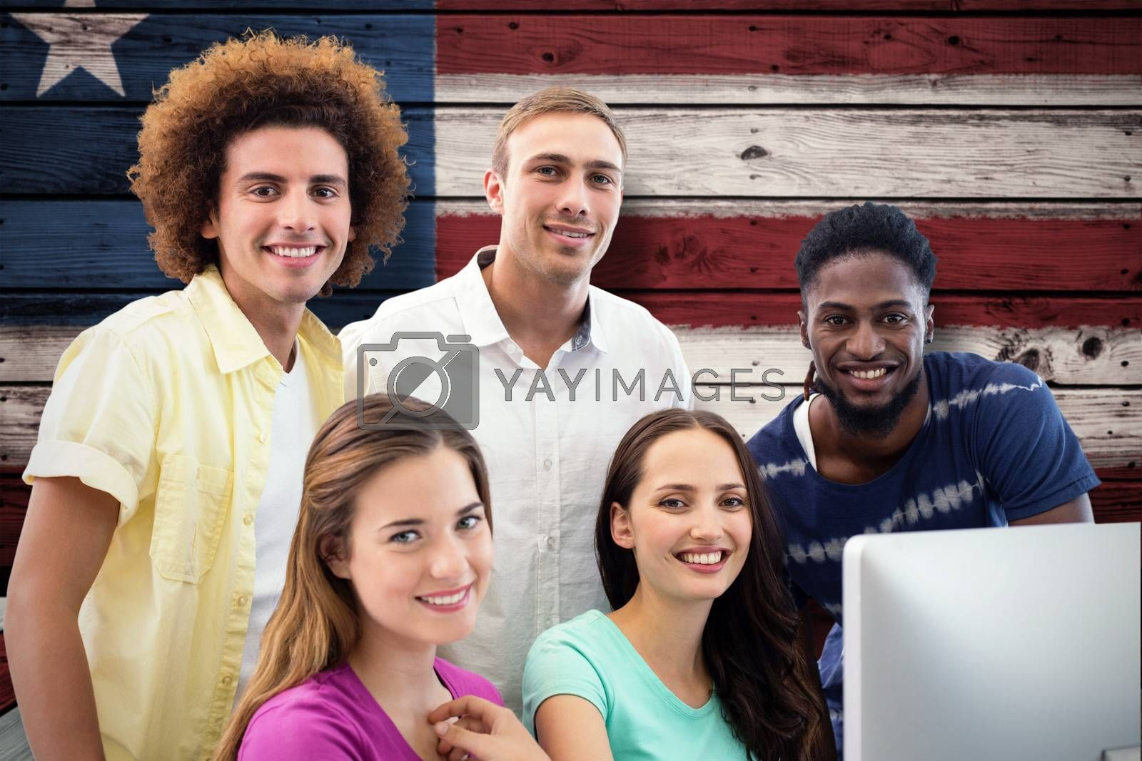 Smiling students in computer class against composite image of usa national flag