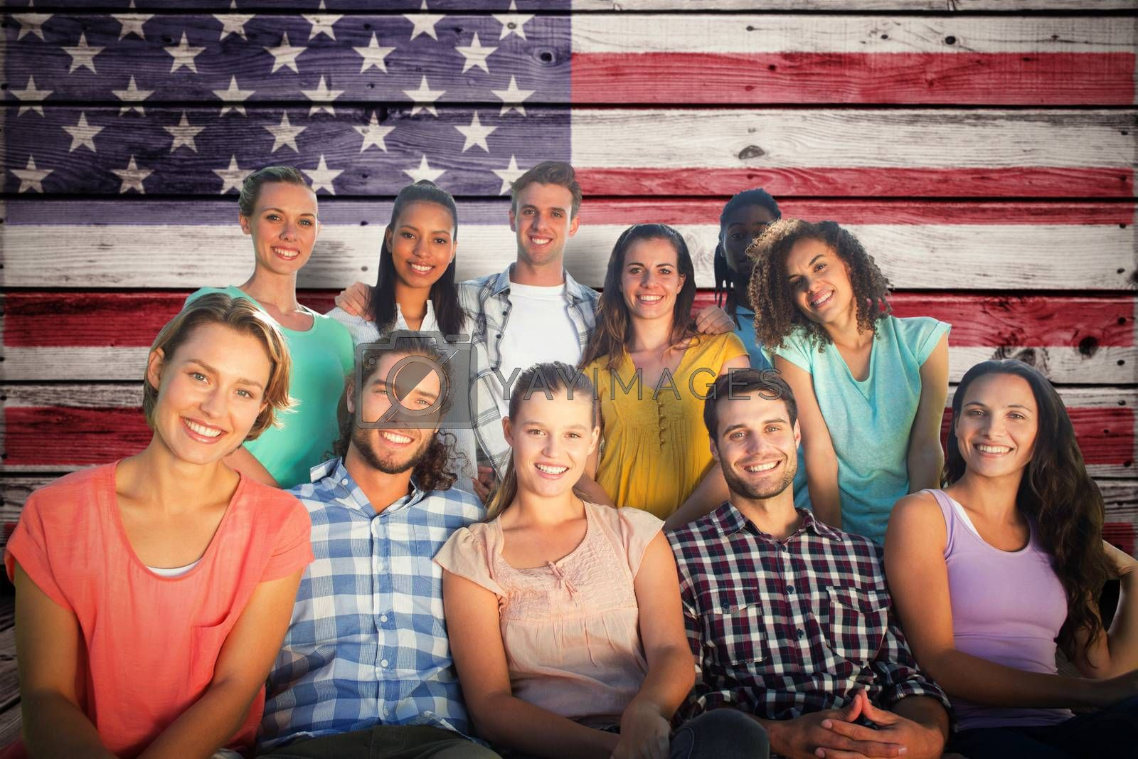 Friends smiling at camera against composite image of usa national flag