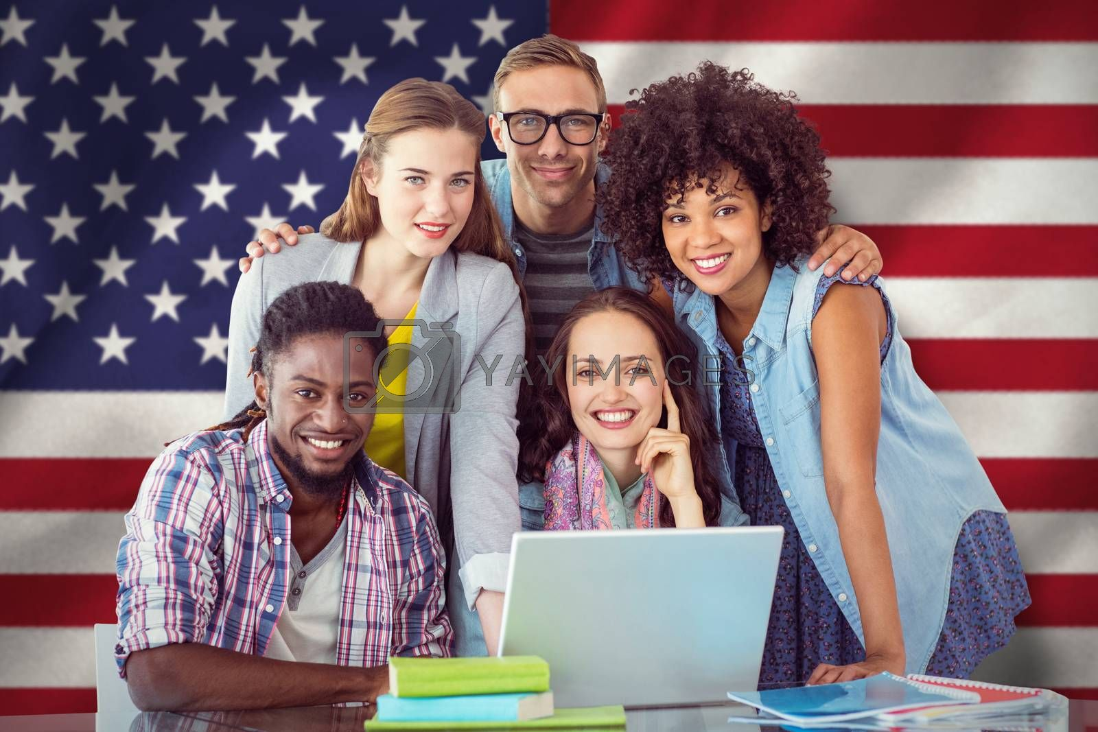 Fashion students working as a team  against digitally generated american national flag