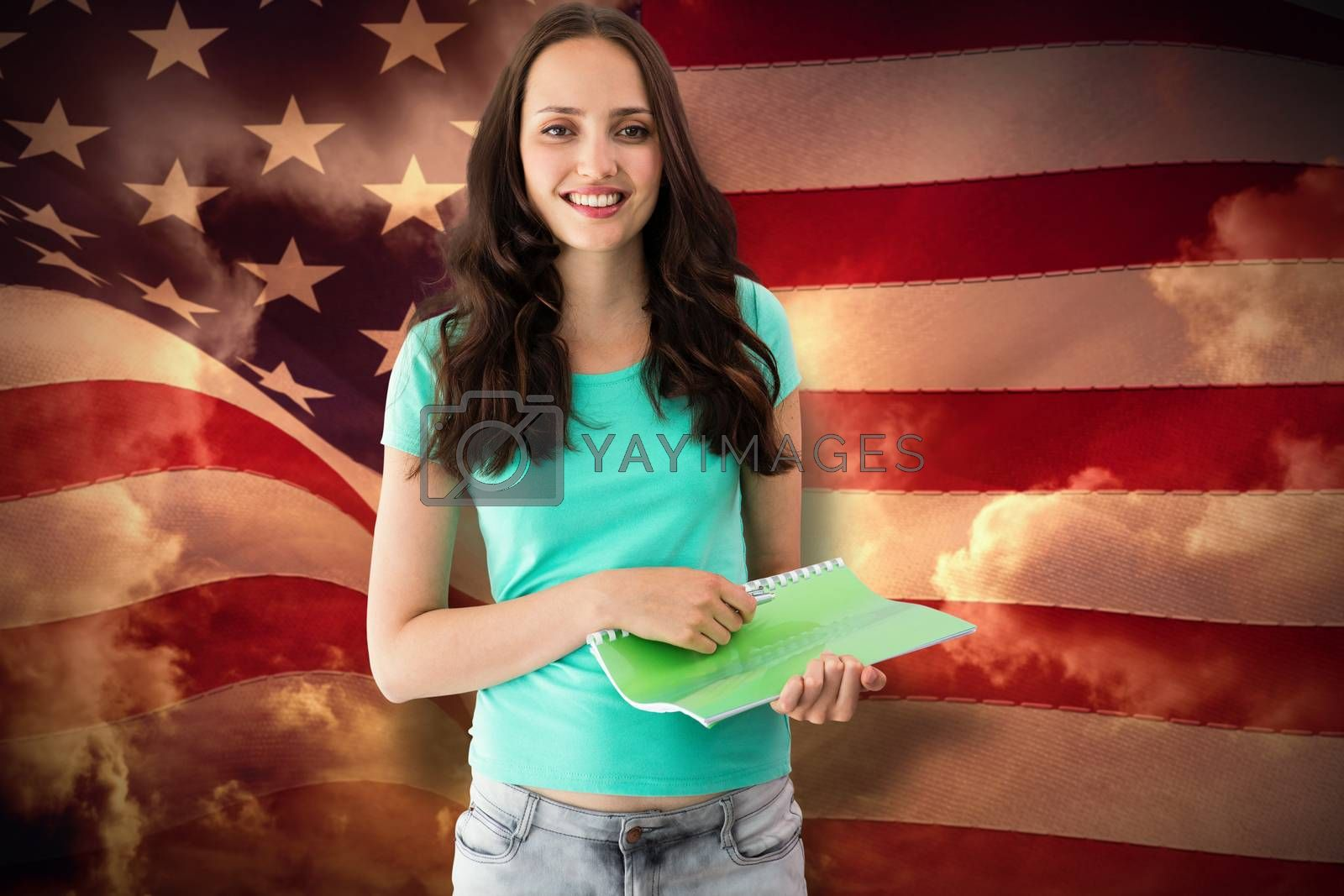 Portrait of smiling young woman with file against composite image of digitally generated united states national flag
