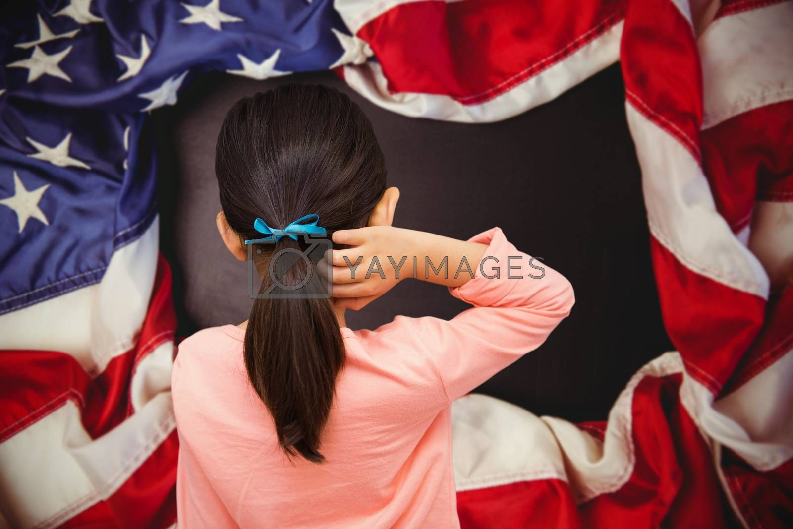 Pupil against american flag on chalkboard
