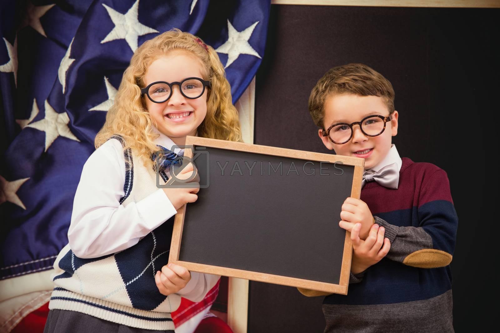 Pupils showing chalkboard against american flag on chalkboard
