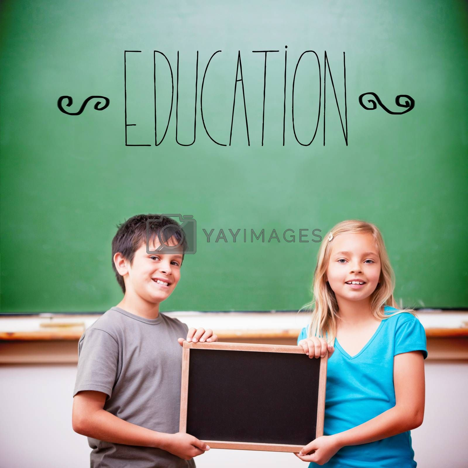 The word education against cute pupils showing chalkboard