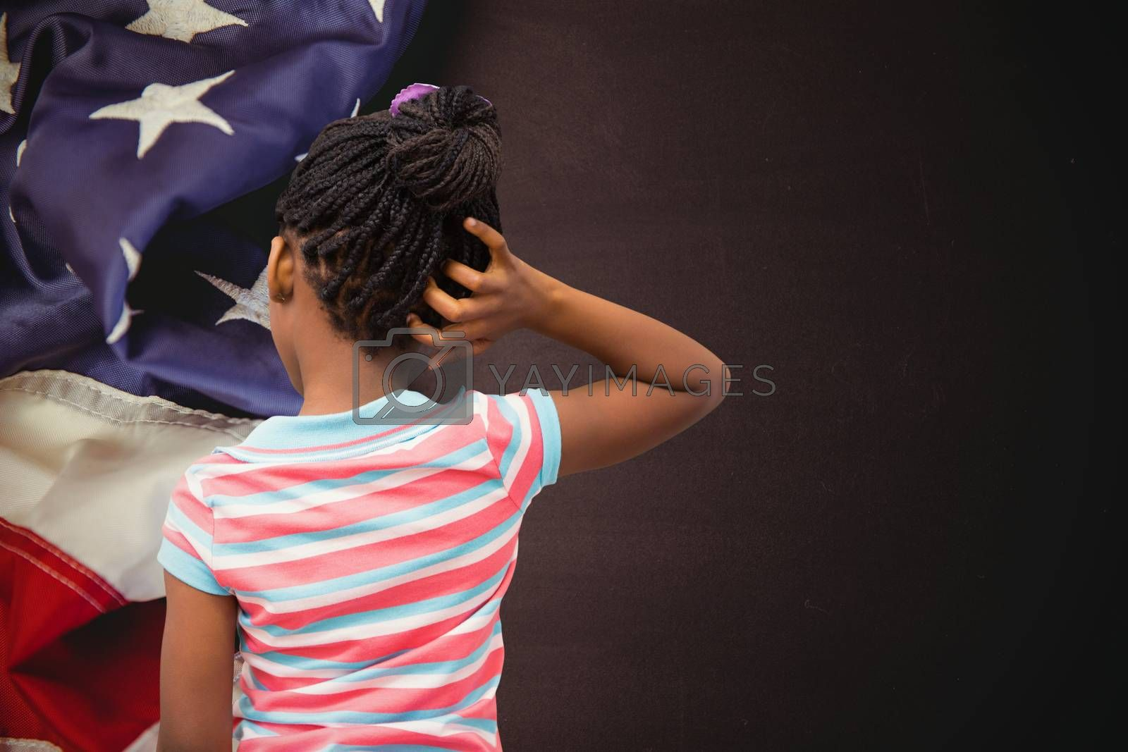 Pupil thinking against american flag on chalkboard