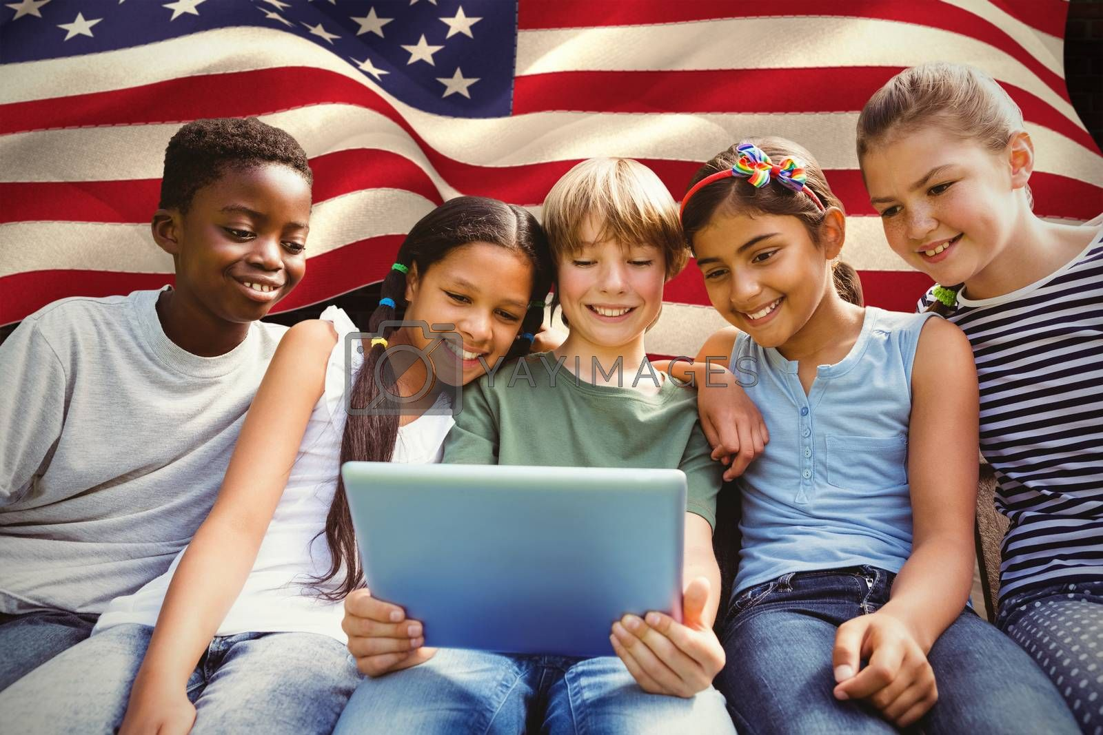 Happy children using digital tablet at park against composite image of digitally generated united states national flag