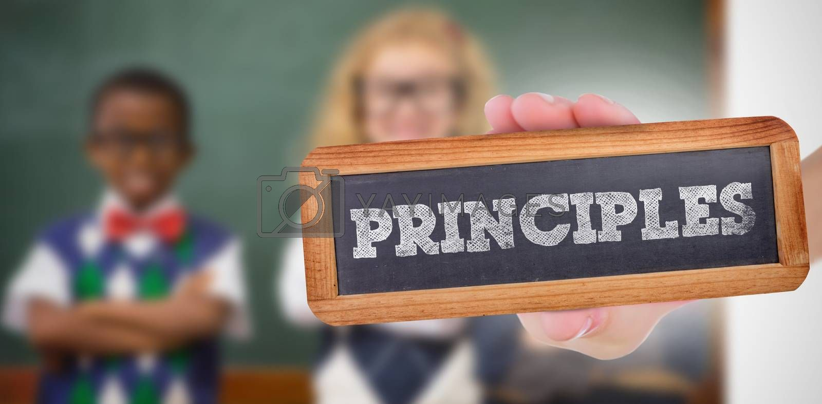 The word principles and hand showing chalkboard against pupils smiling at camera with arms crossed