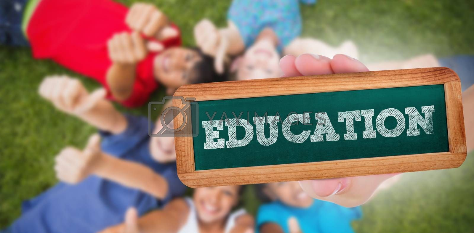 The word education and hand showing chalkboard against happy friends playing in the park