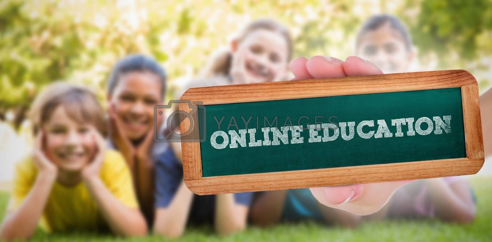 The word online education and hand showing chalkboard against happy friends in the park