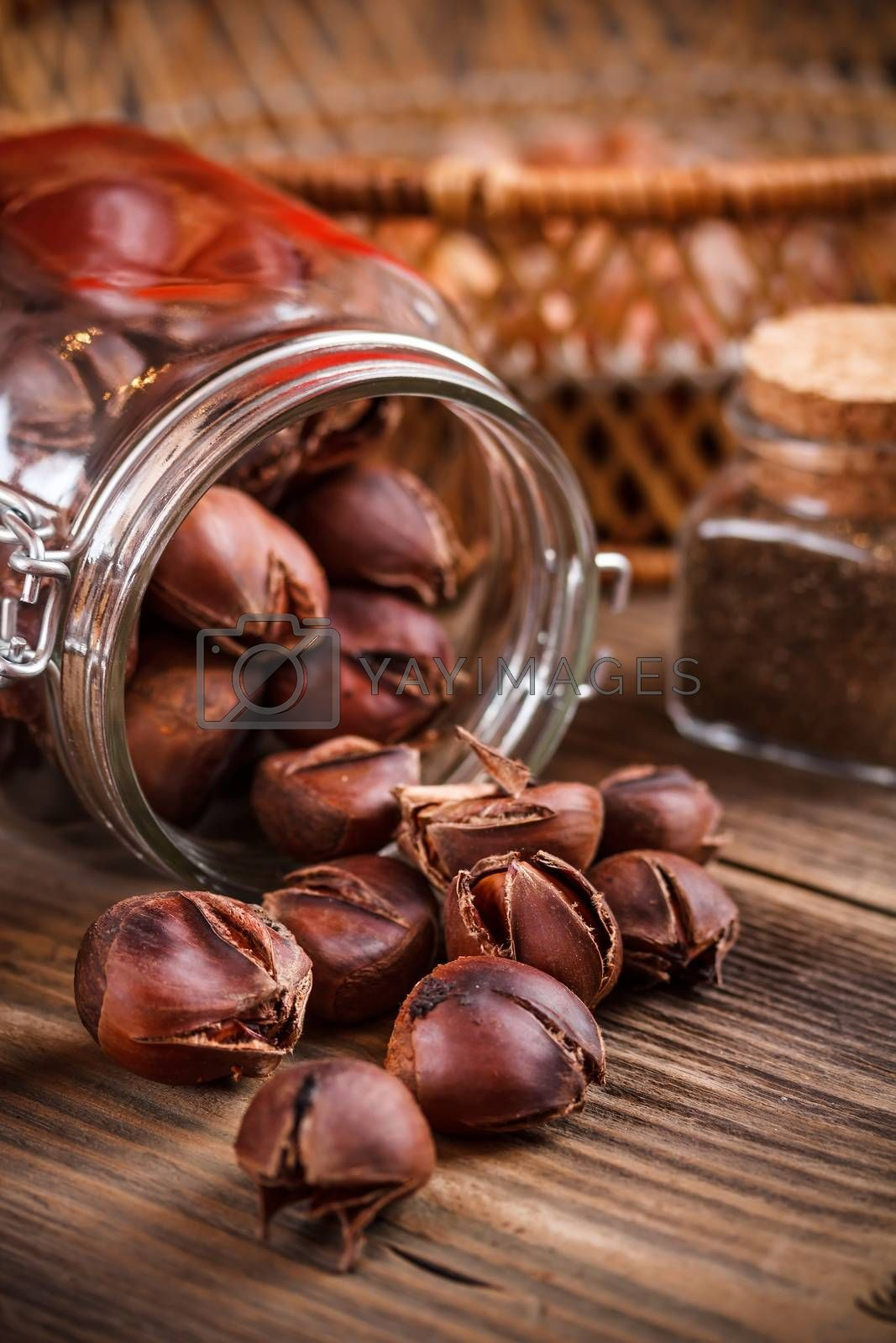 Autumn delicatesse, roasted chestnut on wooden background