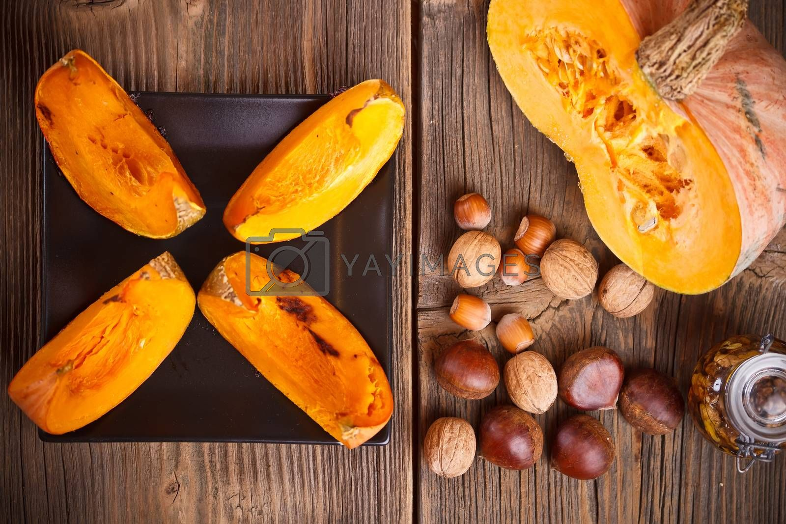 Autumn vegetables and fruits on wooden background