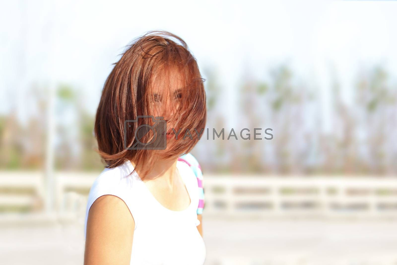 Lady with her hairstyle and hair cover her face