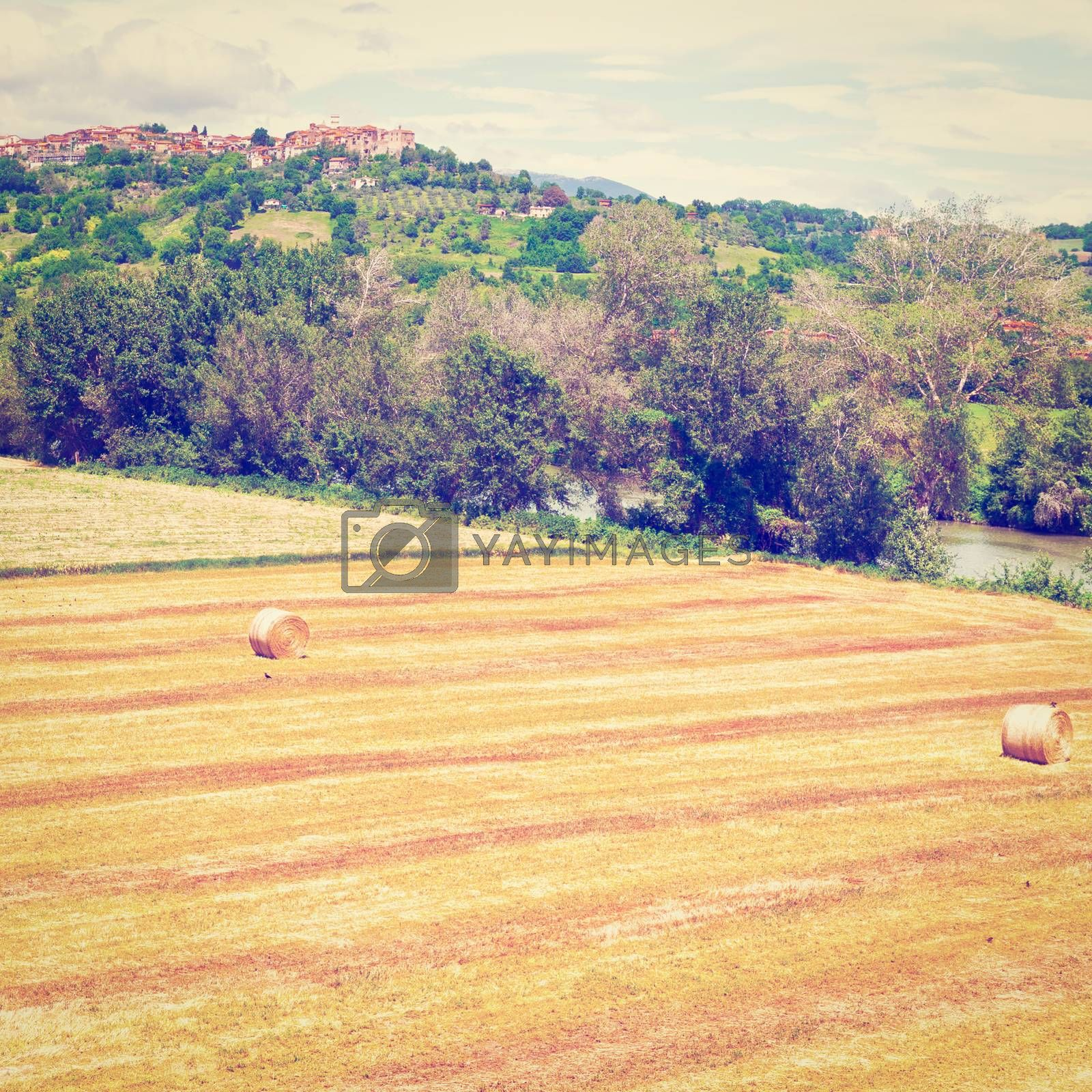 Tuscany Landscape with Many Hay Bales on the Background of the Medieval City, Instagram Effect