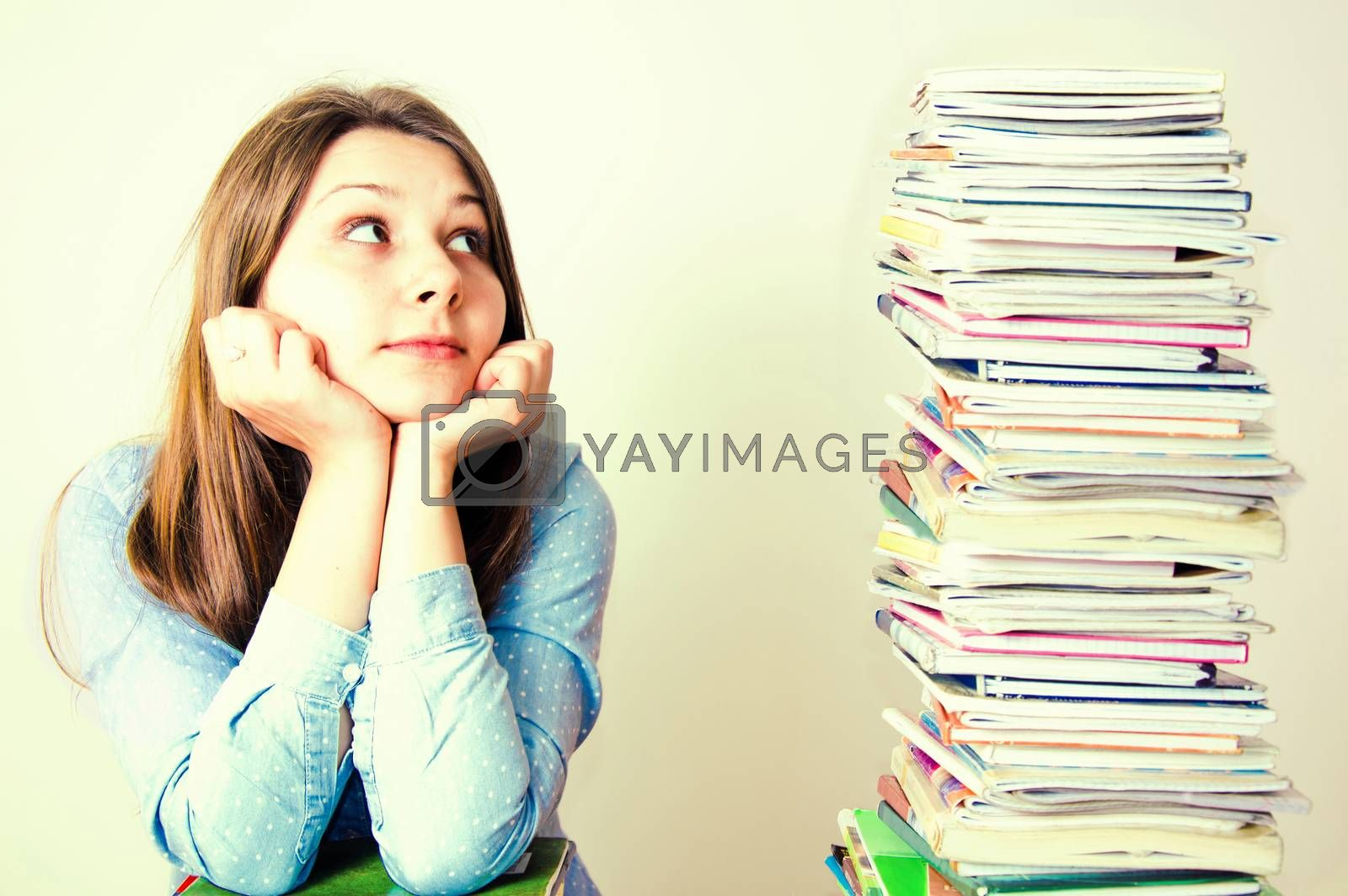 Young student have a lot of work to do. Education conceptual image.