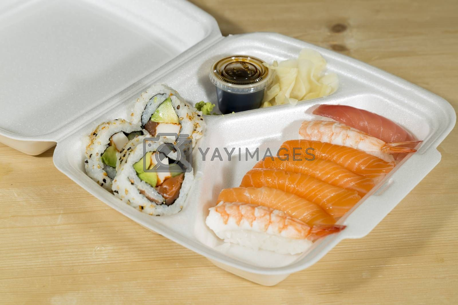 Fast Food Sushi in its box on wooden table.