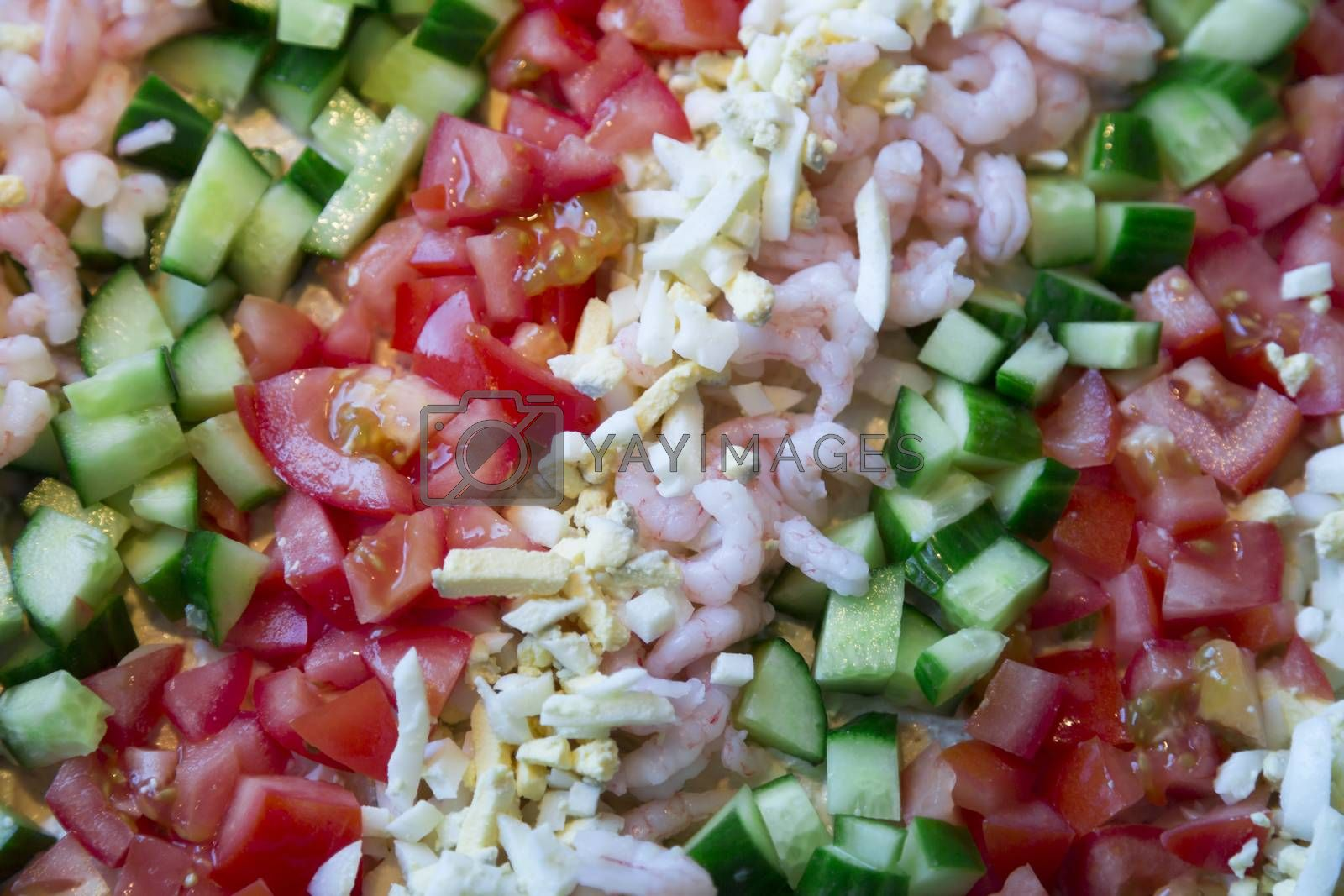 Sandwich layer cake Topping consisting of cucumber, eggs, and tomato.