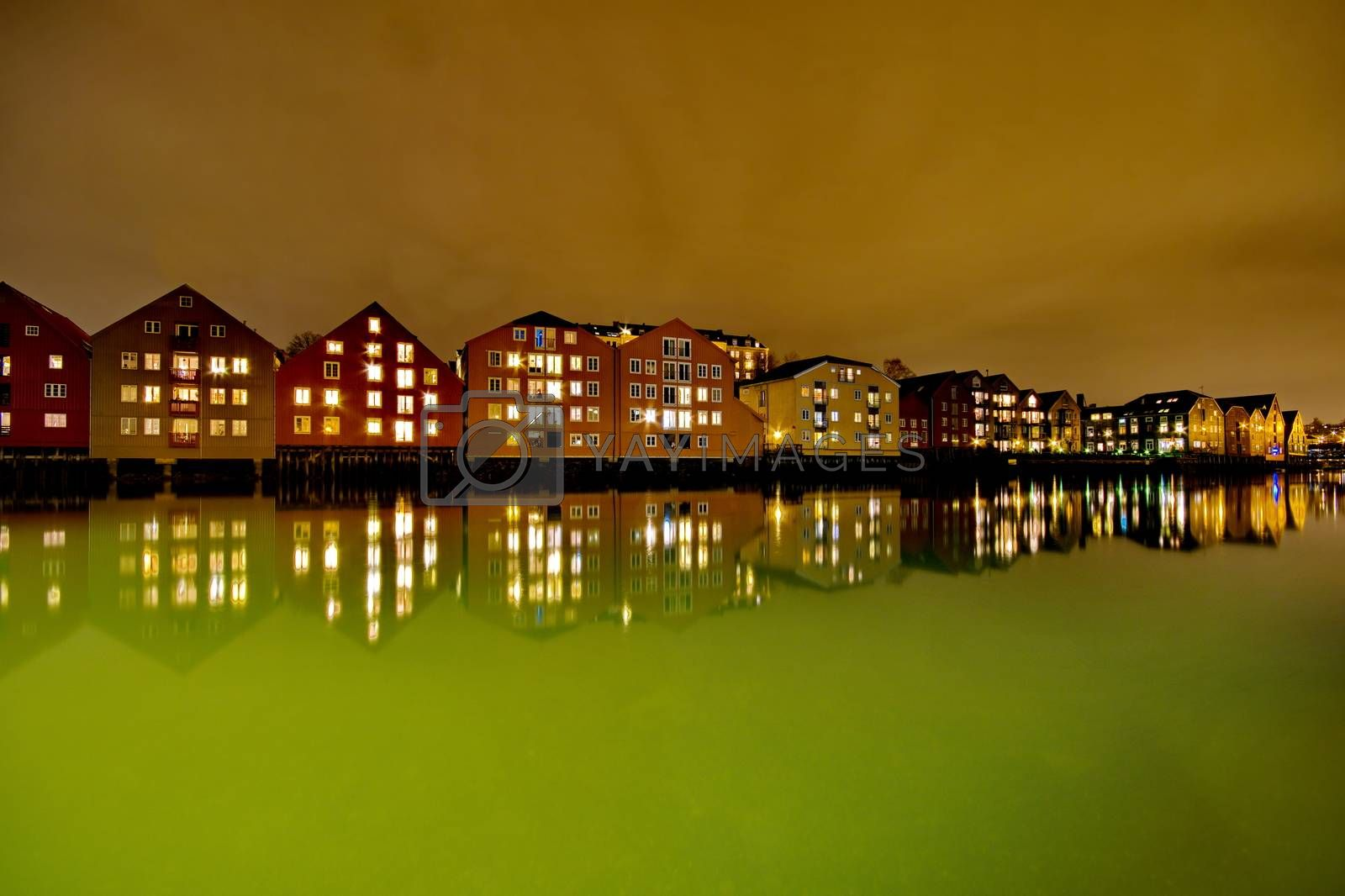 Royalty free image of Houses on the water at night in Trondheim, Norway by anderm