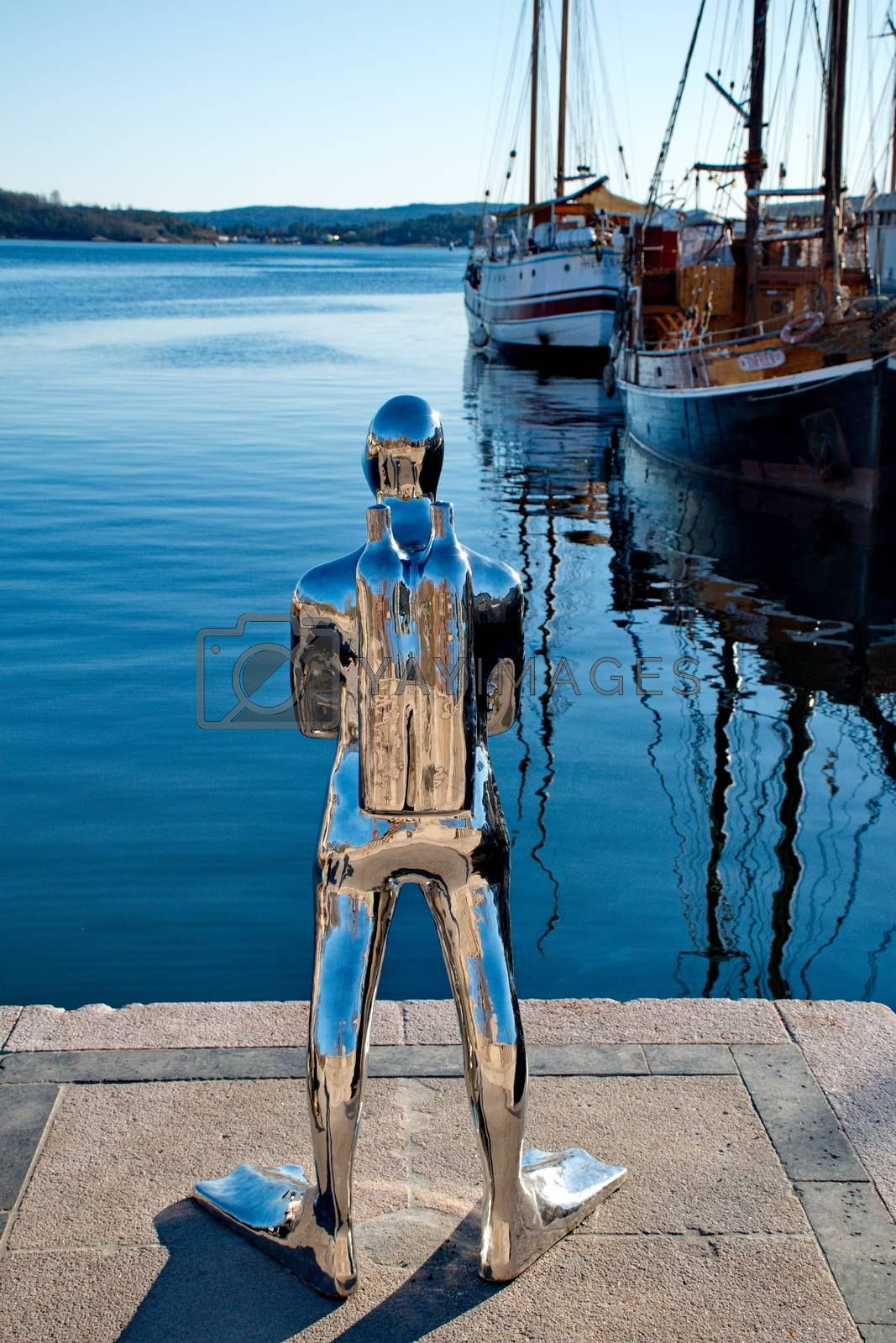 Royalty free image of OSLO - MARCH 21: Contemporary scuplture of a diverr in Oslo harb by anderm