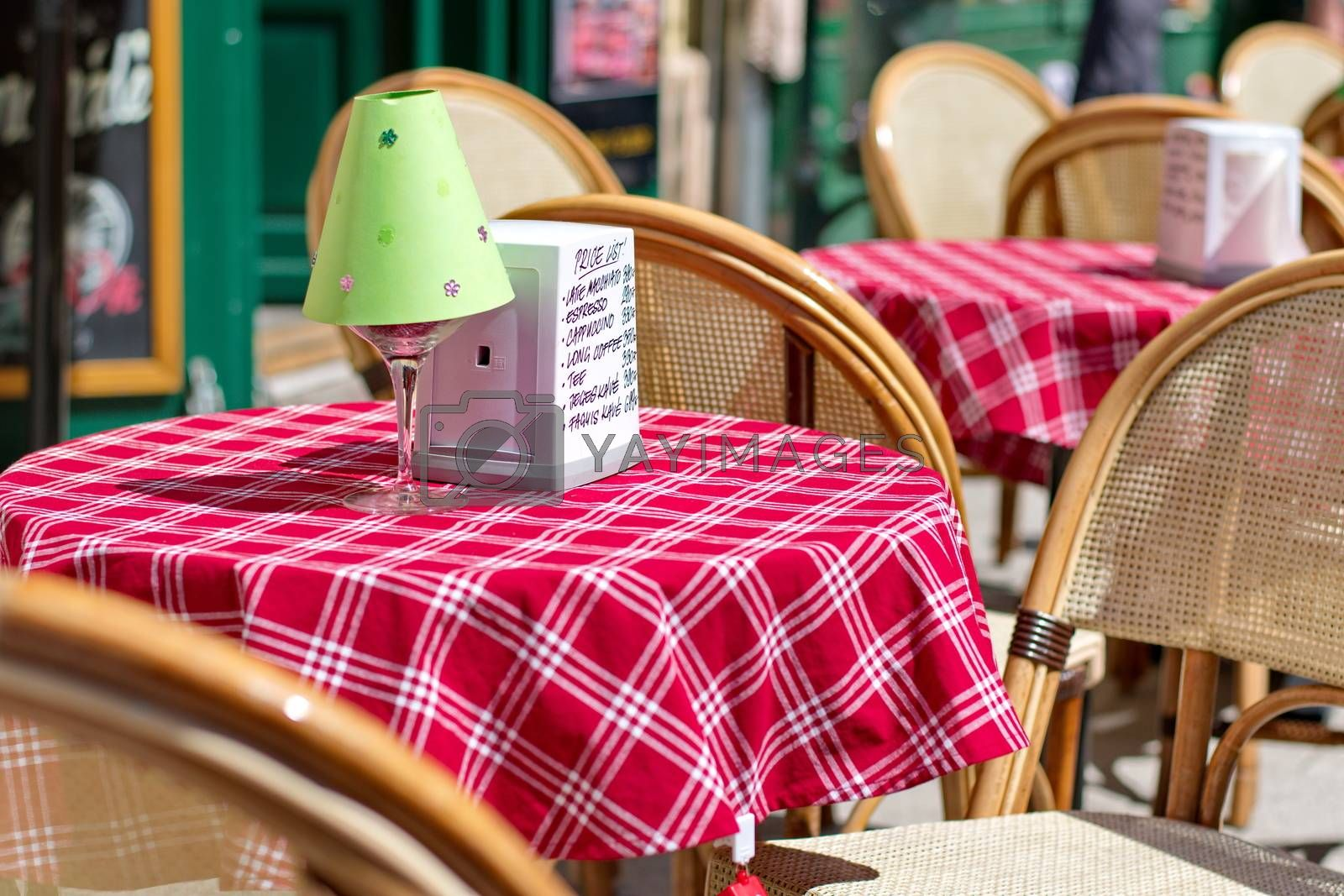 Royalty free image of Empty cafe in the street by anderm