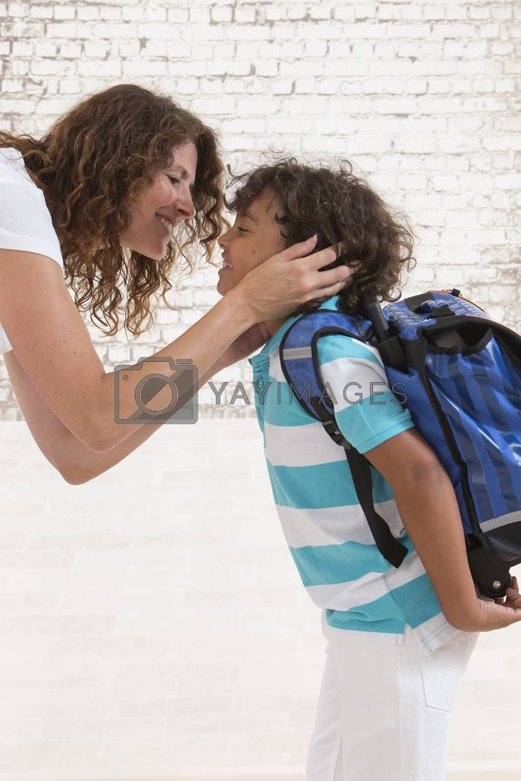 Child hugs mother good-bye before going to shool