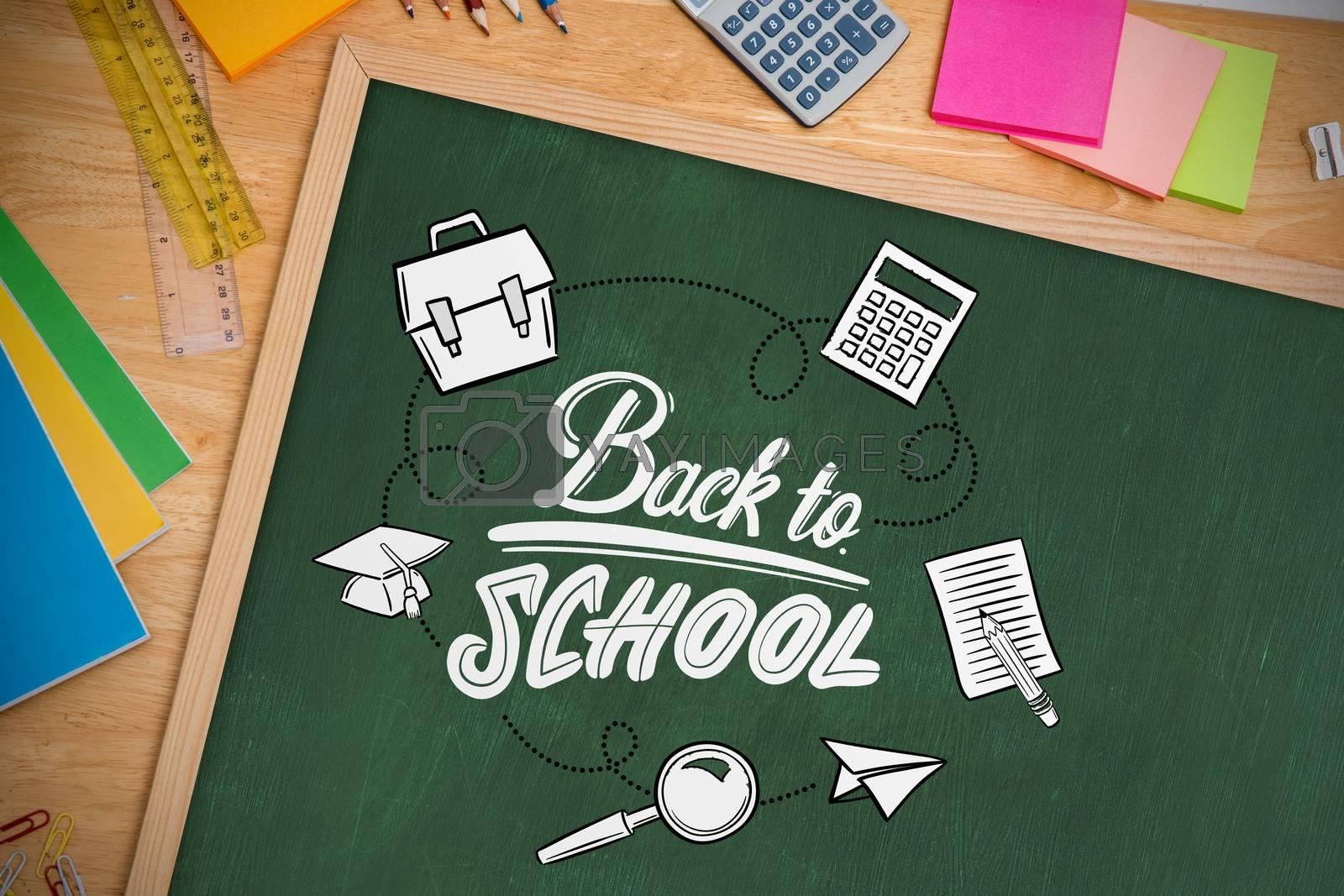 back to school against chalkboard on desk