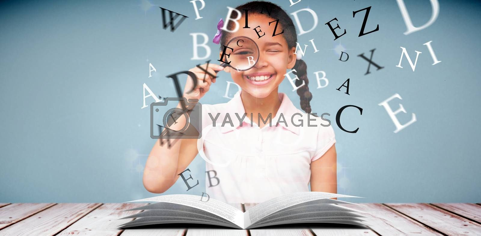 Little girl with magnifying glass against light design shimmering on silver