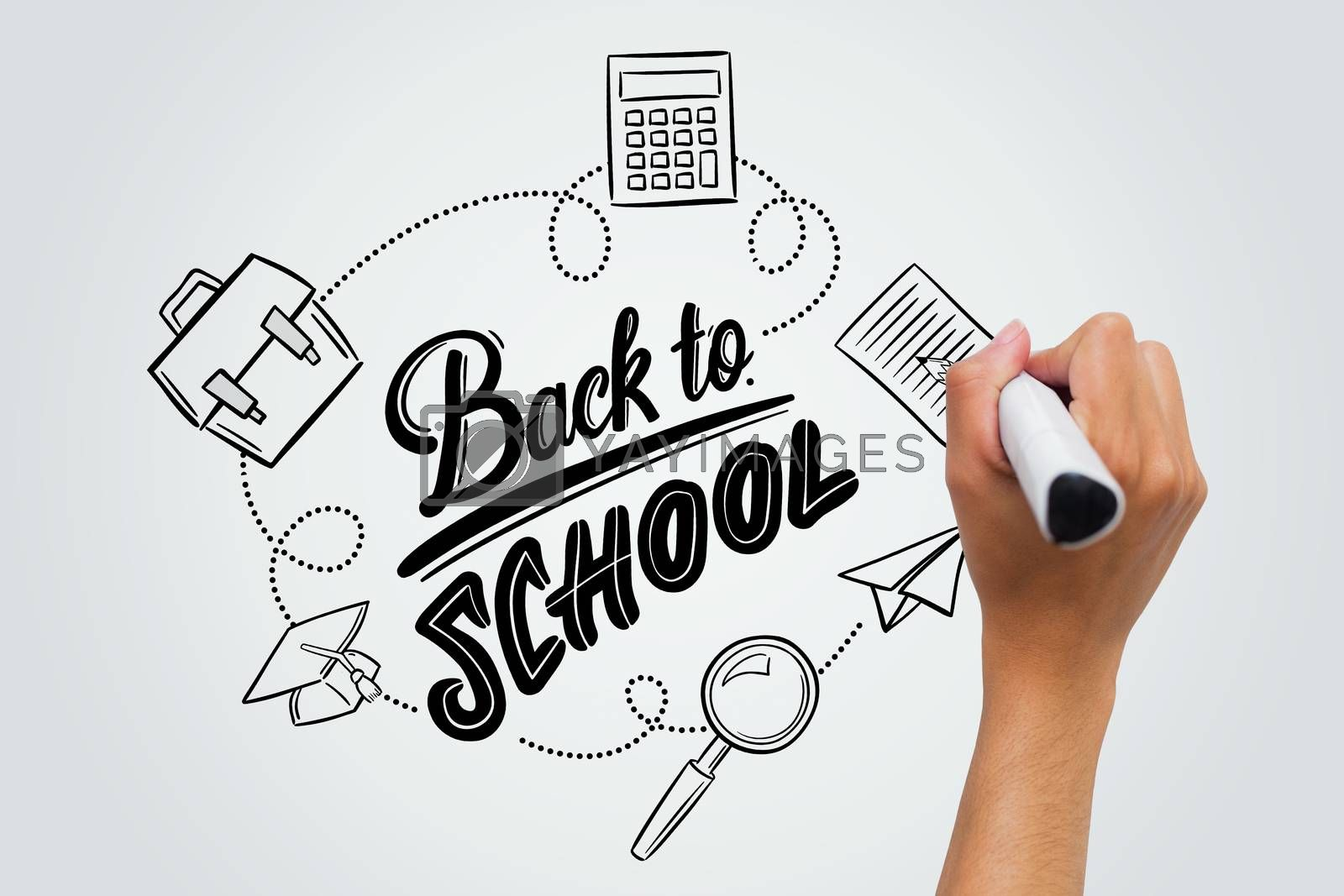 back to school against female hand writing with marker
