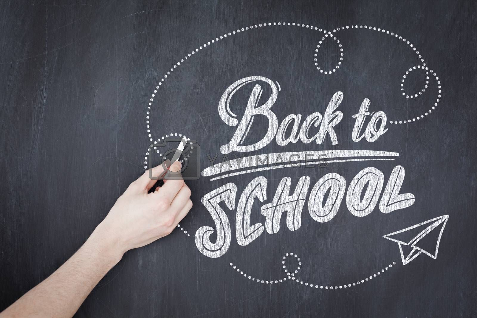 back to school against hand writing with chalk on board