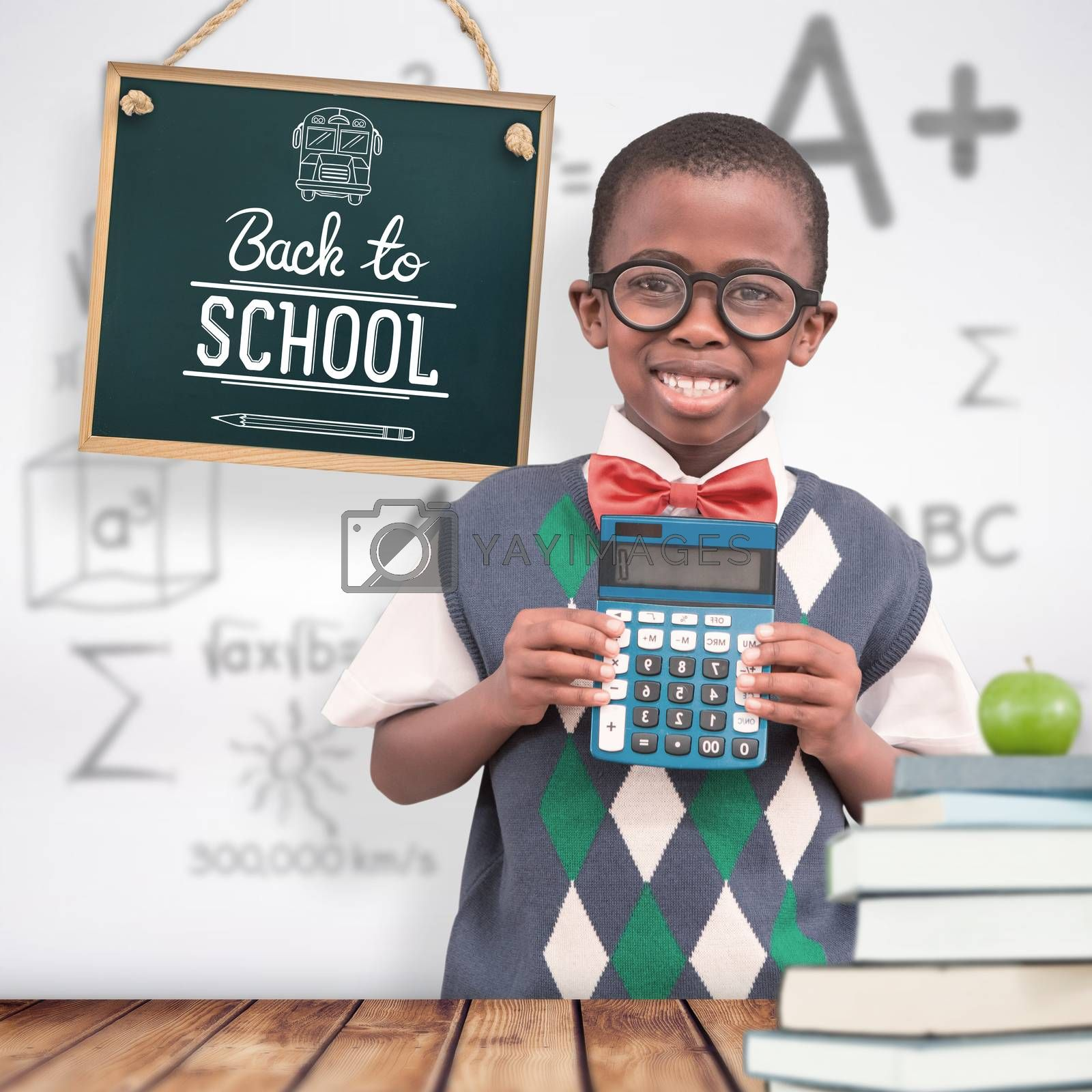 Happy pupil with calculator  against wooden planks background