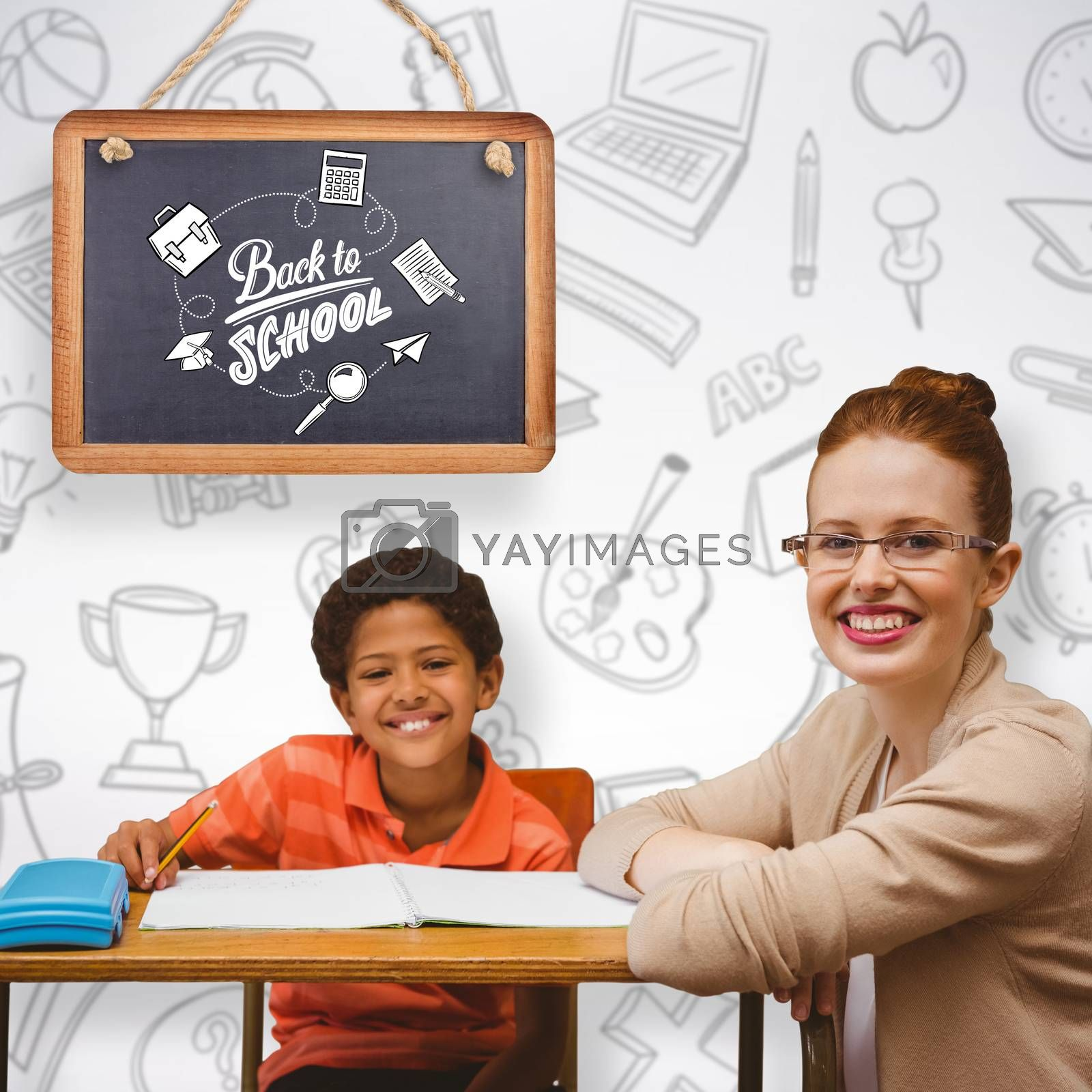 Teacher helping pupil against grey background