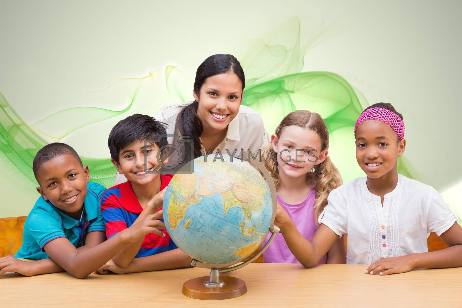 Cute pupils and teacher looking at globe in library  against green abstract design
