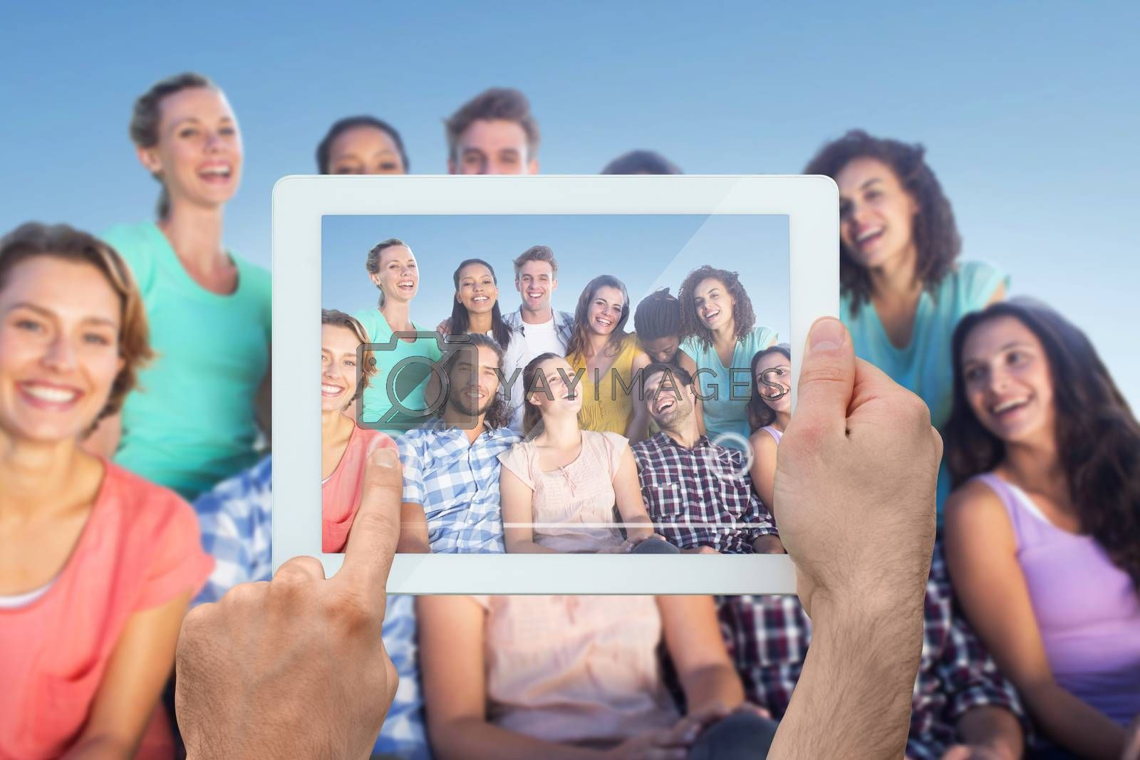 Royalty free image of Composite image of hand holding tablet pc by Wavebreakmedia