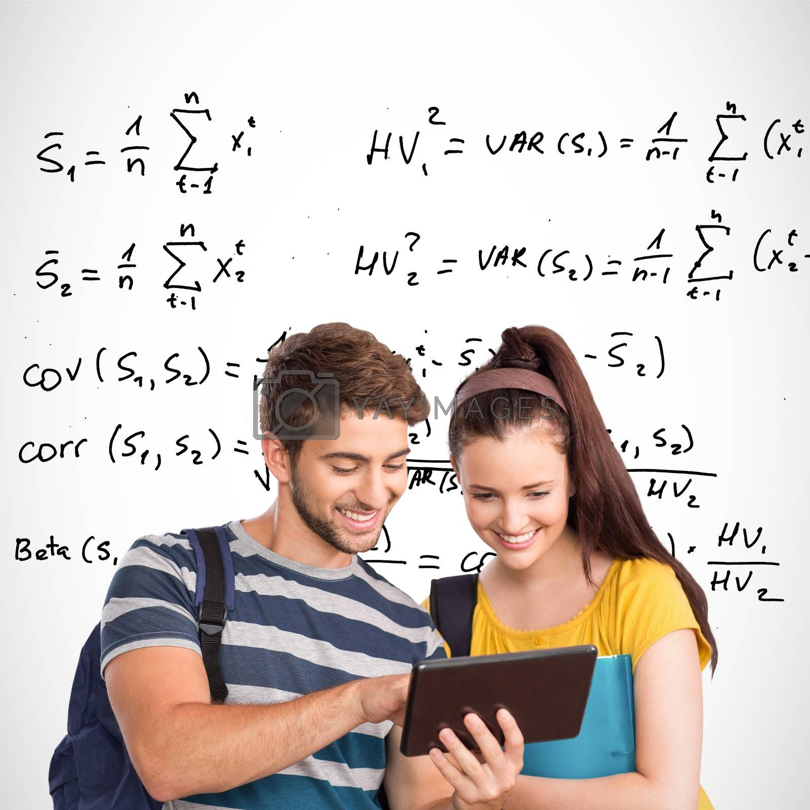 Happy students using tablet pc against maths equations