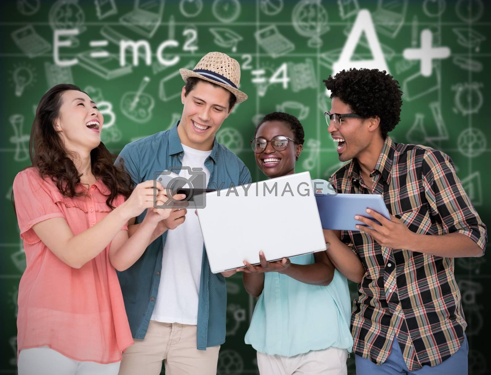 Stylish friends using their technology against green chalkboard