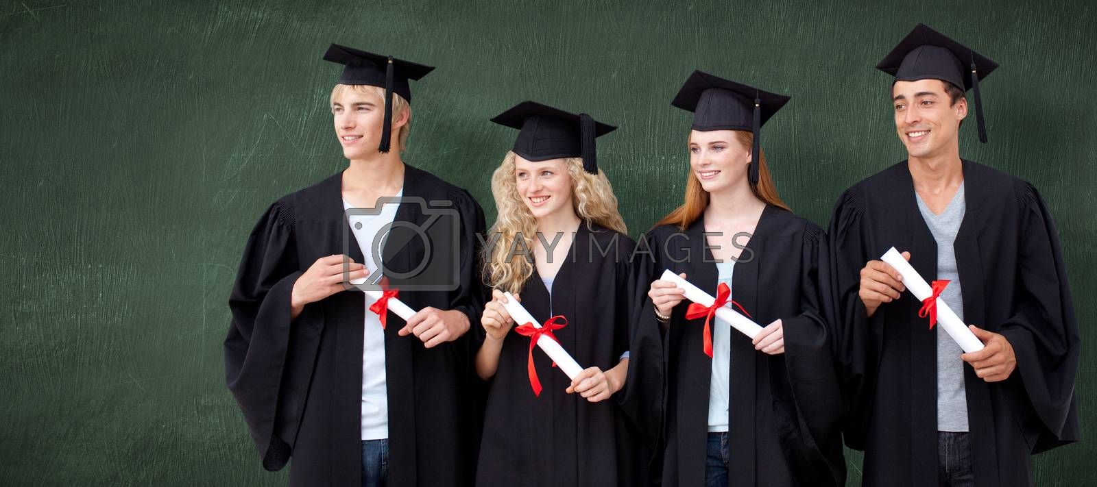 Group of people celebrating after Graduation against green chalkboard