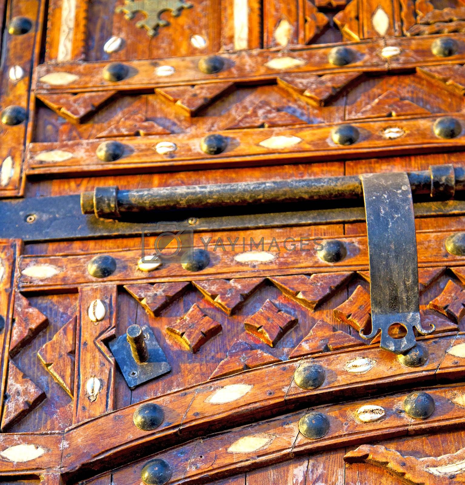 Royalty free image of grey metal rusty      morocco in africa the old wood  facade hom by lkpro