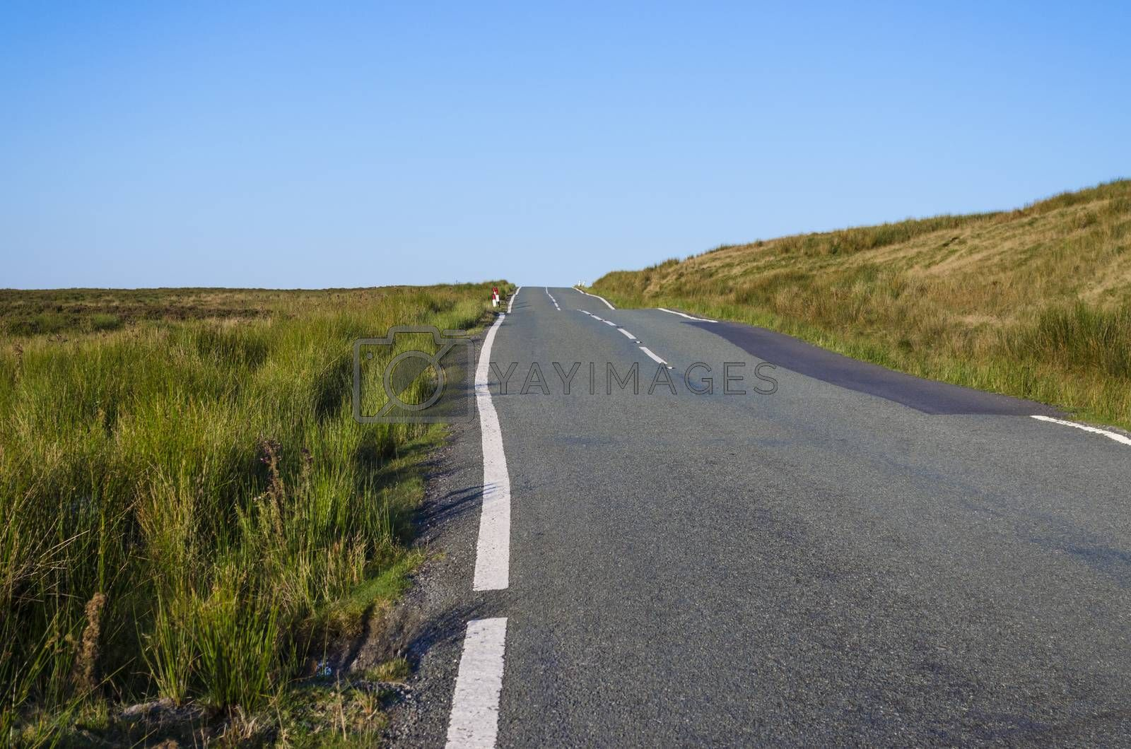 Royalty free image of Country lane across moorland by JohnDavidPhoto