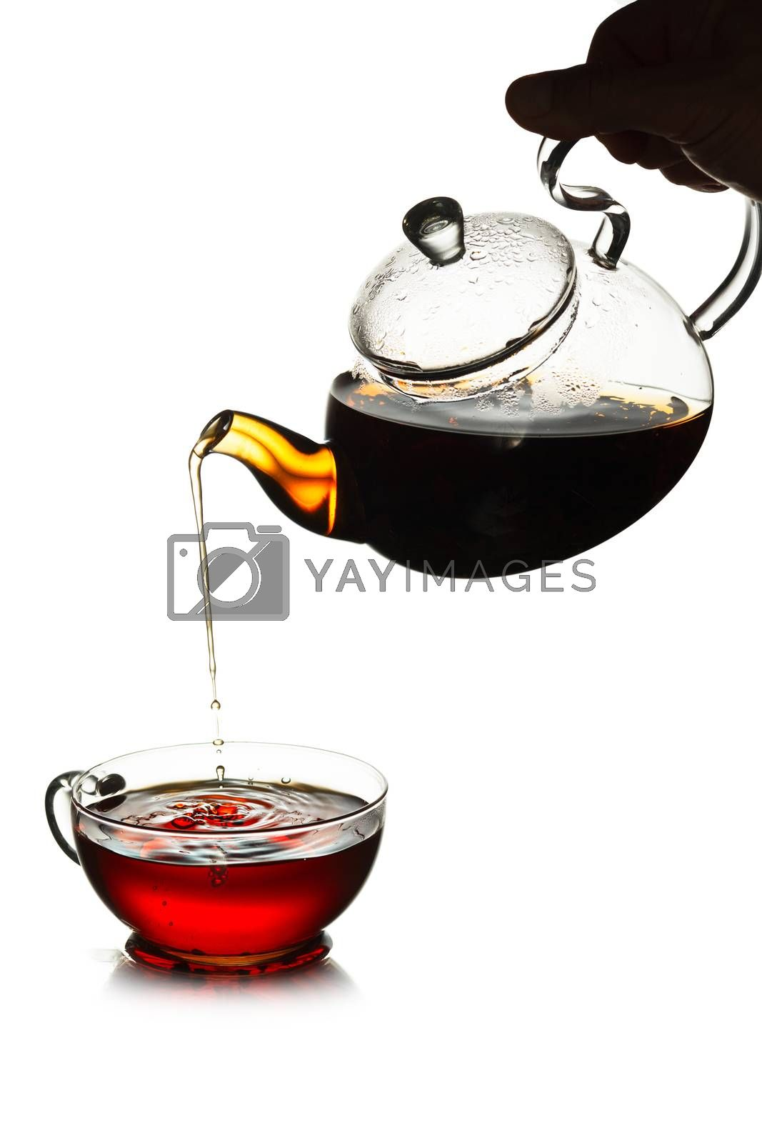 Royalty free image of Tea pouring concept by maxsol