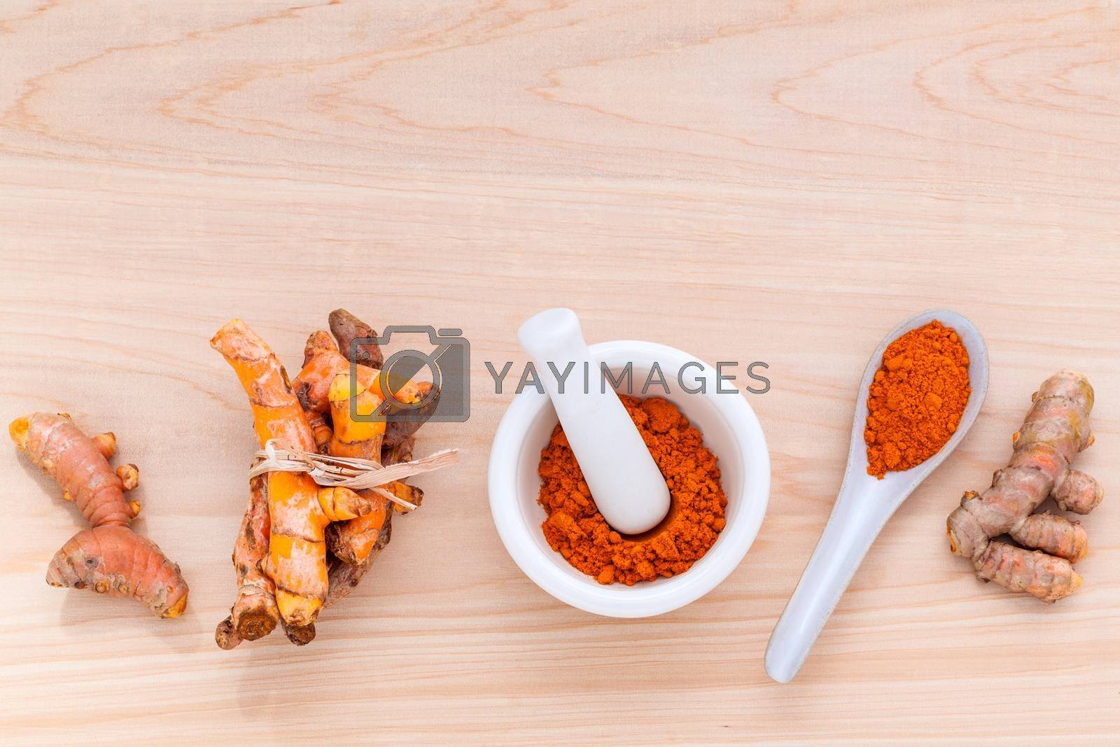 Royalty free image of Turmeric for alternative medicine herbal supplements and herbal  by kerdkanno